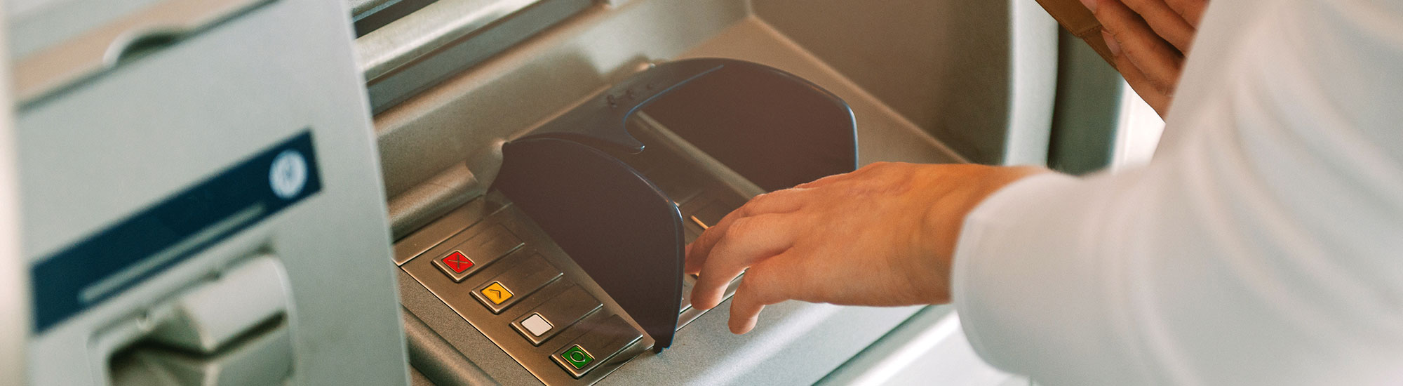 close-up of person using ATM
