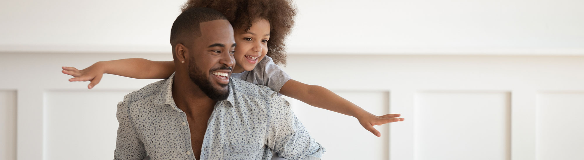 young father playing with daughter